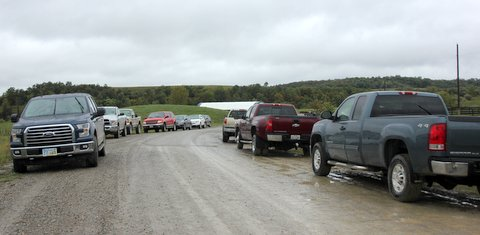 Trucks begin parking on Muskrat Rd in front of the Guest Pavilion prior to the 10 AM first presentation.