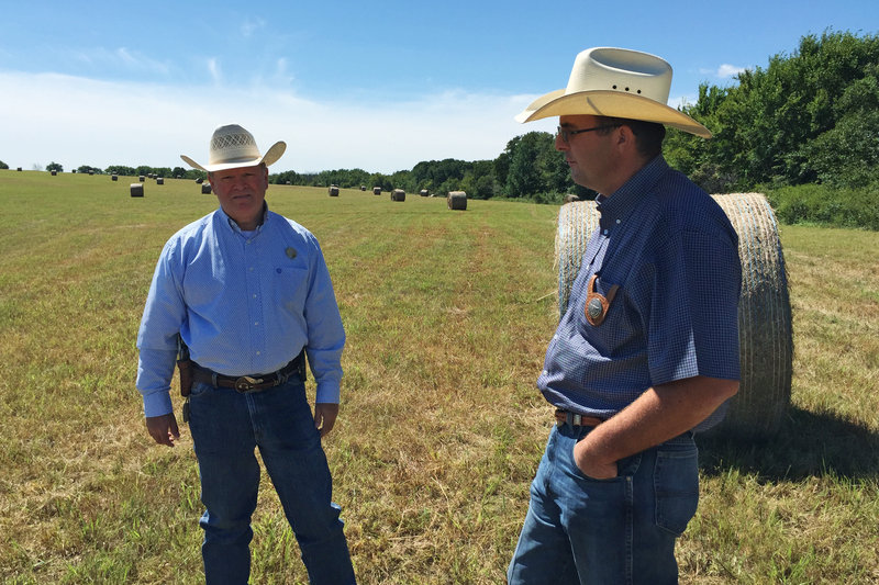 John Cummings (left) and Bart Perrieron are 'cowboy cops' -- they're special rangers with the Texas & Southwestern Cattle Raisers Association, which investigates agricultural crimes in Texas and Oklahoma. Cummings says cattle rustling is a crime with 'low risk, high reward, really.'
