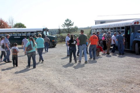Ranch pasture trained buses rolled with full loads of guests, touring pastures, learning about high omega-3 beef and great Texas Longhorn cattle.