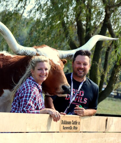 Famous WWVA talk show host Bloomdaddy ate his full share of Longhorn beef, and poses with the world's gentlest steer.