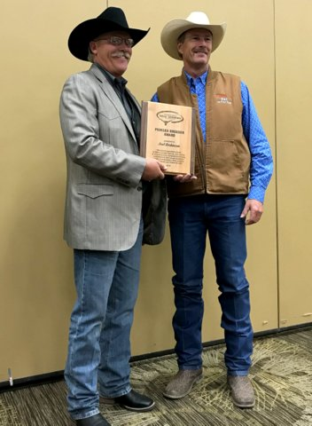 ITLA President Larry P Smith II presents the Pioneer Breeder Award for 2019to Joel Dickinson during the annual convention and banquet. Dickinson manages Dickinson Cattle Co of Barnesville, Ohio. (Smith L, Dickinson R)