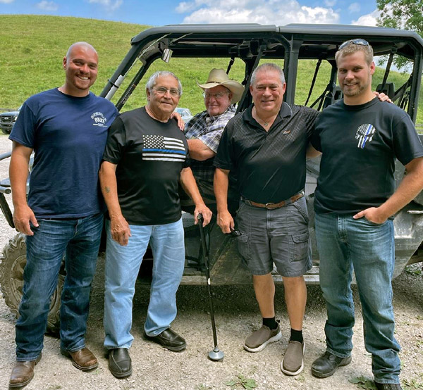 L to R: Some of the special guests at DCC included Barnesville Police Chief, Rocky Sirianni, his dad Fred Sirianni, Belmont County Sheriff, Dave Lucas, and his son Patrolman Cody Lucas. Darol Dickinson in the back row.